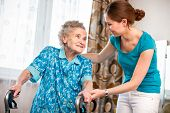pic of granddaughters  - Senior woman with her caregiver at home - JPG