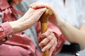 stock photo of trust  - Senior woman with her caregiver at home - JPG