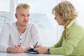 pic of compassion  - Teenager having a  therapy session while therapist is taking notes - JPG