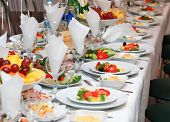 image of catering  - tables set for fine dining during a wedding event. Shallow depth of field.