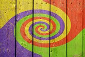 stock photo of 2x4  - A colorful swirl pattern painted on 2X4 boards - JPG