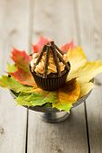 picture of guy fawks  - Cupcakes with orange icing swirl with chocolate fingers as logs - JPG