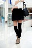 image of short skirt  - Female model in cute trendy outfit for shopping office or study - JPG