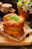 stock photo of frizzle  - pile of homemade freshly fried potato cakes on rural table - JPG