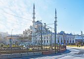 image of tram  - The Yeni Cami Mosque behind the tram line on Galata Bridge Istanbul Turkey - JPG