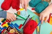 stock photo of handicrafts  - three hands and a lot of handicraft materials - JPG