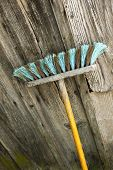 pic of household farm  - Focus on a brush on a wooden wall - JPG