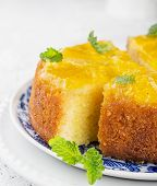 stock photo of upside  - Orange Upside Down Cake with vanilla and honey on wooden background - JPG