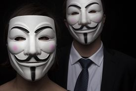 picture of guy fawks  - two members of anonymous activist hacker group with mask studio shot - JPG