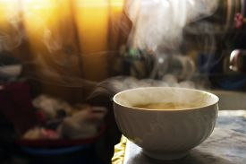 stock photo of steam  - Steaming hot soup in a bowl in the kitchen under warm sunlight. ** Note: Soft Focus at 100%, best at smaller sizes - JPG