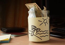 stock photo of budget  - jar of money for travelling on the table - JPG