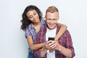 Постер, плакат: Happy couple making photos