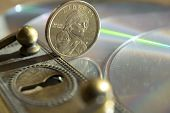 picture of keyhole  - concept of monetary and banking security through a keyhole and some money - JPG