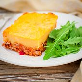 picture of mashed potatoes  - A Slice of Mashed Potato Pumpkin and Tomato Minced Meat Bake square - JPG