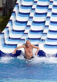 picture of toboggan  - Senior man enjoying holiday in aqua park - JPG
