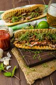 picture of cheesesteak  - Steak sandwich with herbs lime and microgreens with little bit kick of hot sriracha souce - JPG
