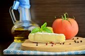image of brie cheese  - cheese brie and olive oil on a dark background  - JPG