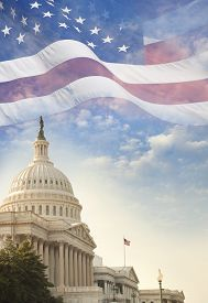 image of superimpose  - The US Capitol building with a waving American flag superimposed on the sky - JPG