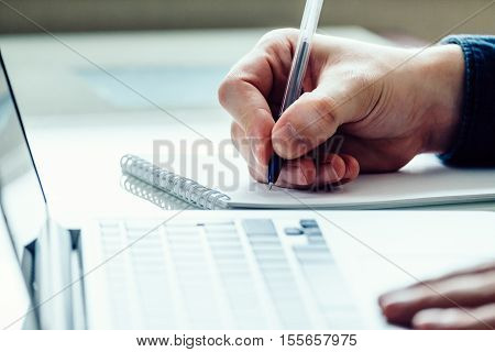 Hand With Pen In Office