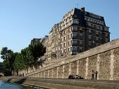 picture of reunited  - French apartment buildings and some people reunited by the Seine Riverside during the afternoon - JPG