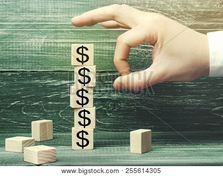 poster of Businessman Removes A Cube With A Picture Of Dollars. Financial And Economic Crisis. Capital Outflow