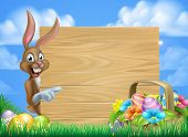 Cartoon Easter Background Of Easter Bunny And Easter Basket Full Of Decorated Chocolate Easter Eggs  poster