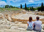 A Couple Of Tourists Admiring The Theatre Of Dionysus Eleuthereus. Acropolis Of Athens. Attica Regio poster