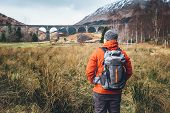 Hiking, Walk With Backpack, Active Lifestyle Concept Image. Man Traveler Walks Neaar Famous Glenfinn poster