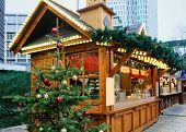 Постер, плакат: Stand With Sweets At Christmas Market At Kaiser Wilhelm Memorial Church In Winter Berlin Germany A