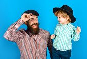 Happy Father And Son In Hats. Parenthood. Fathers Day Celebration. Dad And Son In Checkered Shirts  poster