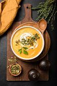 Pumpkin Soup In Bowl Garnished With Cream And Pumpkin Seeds. Top View. Autumn Fall Comfort Food. Cre poster