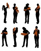 stock photo of siluet  - Silhouettes of the mother with baby - JPG