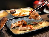 Grilled Pork Slice Topped With Japanese Sauces On Beautiful Dish Clay Pot. Traditional, Pork Slice O poster