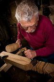 stock photo of woodcarving  - Old woodcarver work in the workshop 3 - JPG