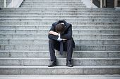Desperate Alone Businessman After Big Fail Sitting On The Stairs poster
