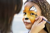 Children Face Painting. Artist Painting Little African-american Girl Like Tiger, Copy Space poster