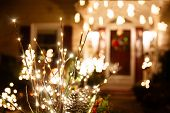 Shining Christmas Decorations Outside The House. Beautiful Glowing Christmas Composition Of Fir Bran poster