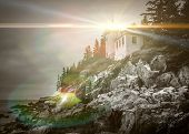 Bass Harbor Head Lighthouse in Maine with dramatic light flare effect poster