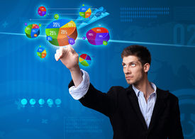 picture of computer technology  - Businessman pressing pie chart button - JPG