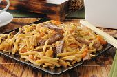 pic of lo mein  - A plate of beef lo mein with chopsticks - JPG