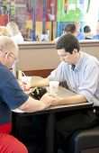 PENSACOLA, FL - AUGUST 1, 2012: Patrons pray at Chick-Fil-A restaurant in Pensacola, FL, on August 1