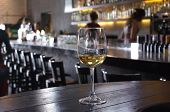 image of wine-glass  - Lonely wine glass on a background of a bar - JPG