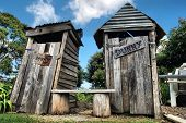 stock photo of outhouses  - Classic country outhouse toilets with waiting area provided - JPG