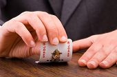 foto of cheater  - Image of Business man showing joker card - JPG