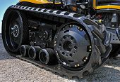 picture of irresistible  - new black excavator outside with rubber crampons - JPG