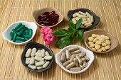 stock photo of ginseng  - Different Herbal Pills - JPG
