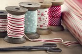 Wooden Ribbon Spools, Paper Rolls And Old Scissors
