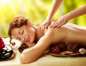 Постер, плакат: Spa Beautiful Woman in Spa Salon getting Massage Healthy massage of body in spa salon Beauty trea