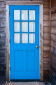 foto of mendocino  - Bright blue door of a Mendocino cabin - JPG