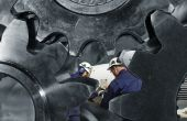 picture of mechanical engineering  - two engineers working inside giant gear machinery - JPG